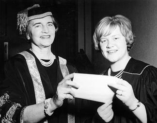Chancellor Phyllis Ross presenting awards to unidentified student
